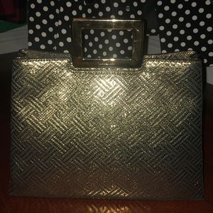 Golden metallic leather purse by Michael Kors.
